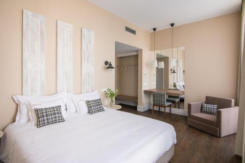 Uma cama ou camas num quarto em Casa das Muralhas