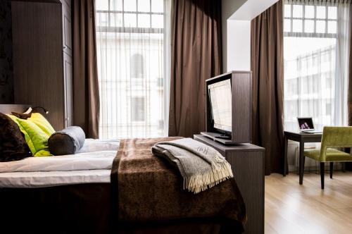 Ein Bett oder Betten in einem Zimmer der Unterkunft Frogner House Apartments - Skovveien 8