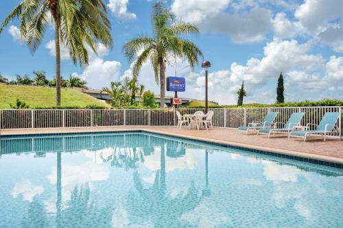 The swimming pool at or near Baymont by Wyndham Florida City