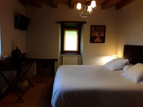 Cama o camas de una habitación en Olagaraia - Adults Only