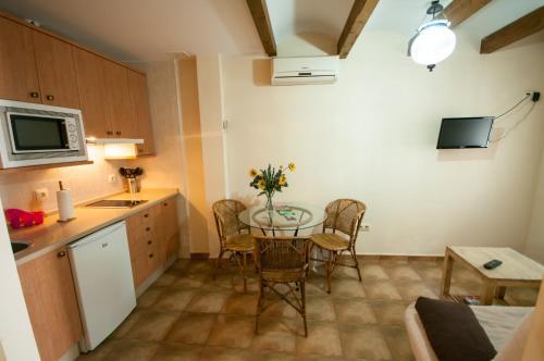 Una cocina o zona de cocina en Apartamentos Turísticos Rincón de la Magdalena