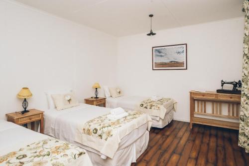 Cama ou camas em um quarto em Hotel Estancia El Ovejero Patagónico