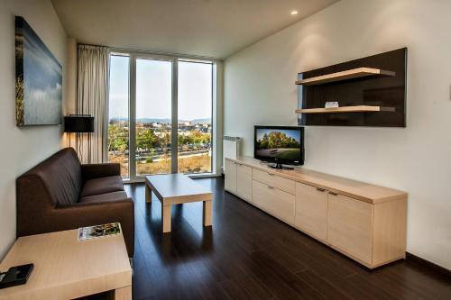 Zona de estar de Hotel Zenit Jardines de Uleta Suites