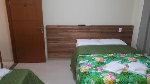 Cama ou camas em um quarto em La Palma Hotel Fazenda