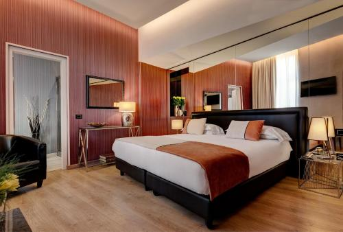 A bed or beds in a room at Dharma Style Hotel