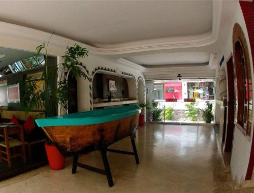 A pool table at Hotel Rio Malecon