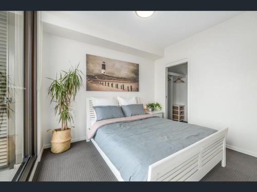 A bed or beds in a room at Arvia Newcastle