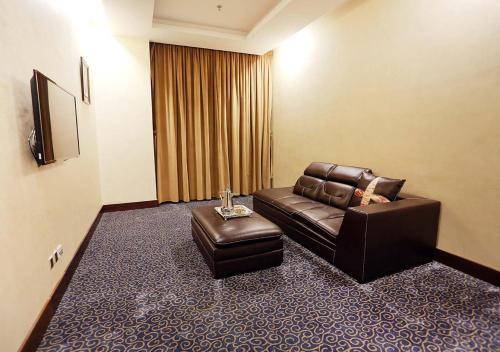 Uma área de estar em Karam Jeddah Hotel