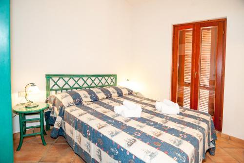 Letto o letti in una camera di Stella Marina Budoni