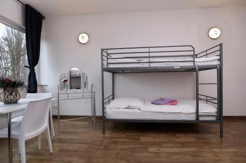 A bunk bed or bunk beds in a room at K&M Hostel