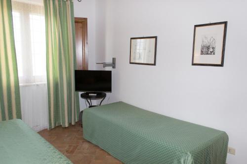A bed or beds in a room at Agriturismo Poggio Delle Conche