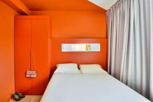Un ou plusieurs lits dans un hébergement de l'établissement ibis Budget Mâcon Crêches