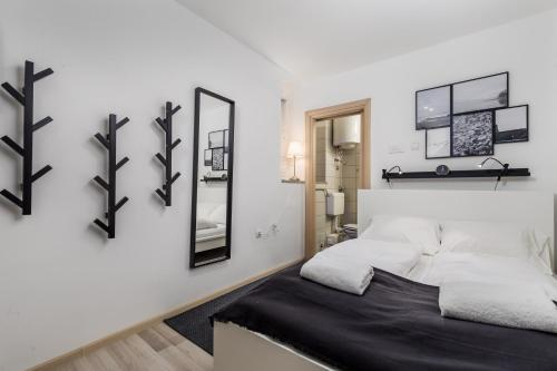 Кровать или кровати в номере Room Andrea