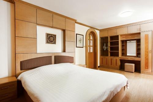 A bed or beds in a room at The Aiyapura Bangkok