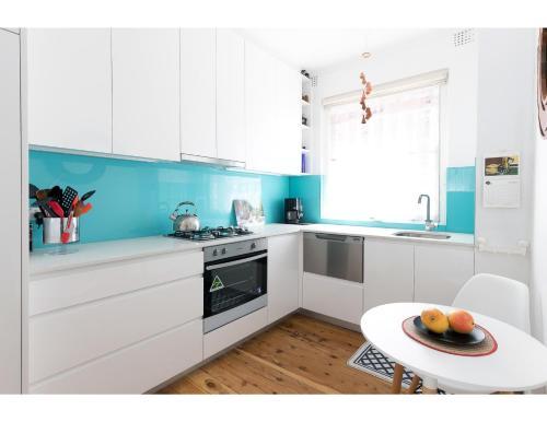 A kitchen or kitchenette at Retro Bondi Beach Garden Apartment