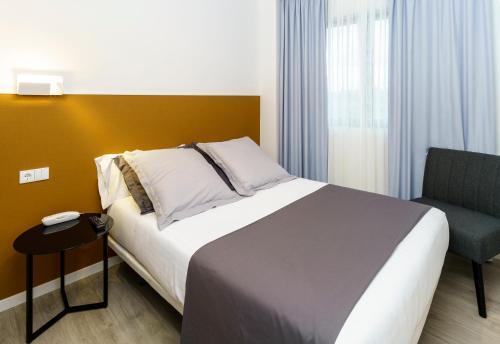 Cama o camas de una habitación en Hotel Concheiros