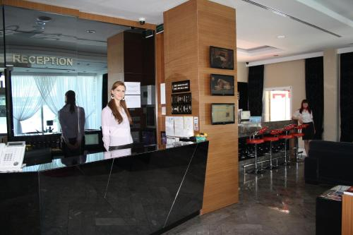 The lobby or reception area at City Hotel Plovdiv