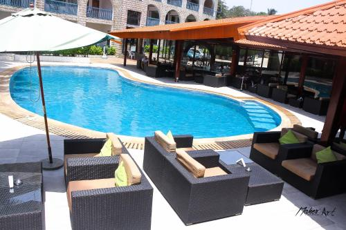 The swimming pool at or near Riviera Taouyah Hotel