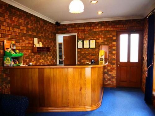 The lobby or reception area at Victoriana Motor Inn