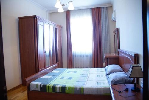 Cama ou camas em um quarto em Nizami Street