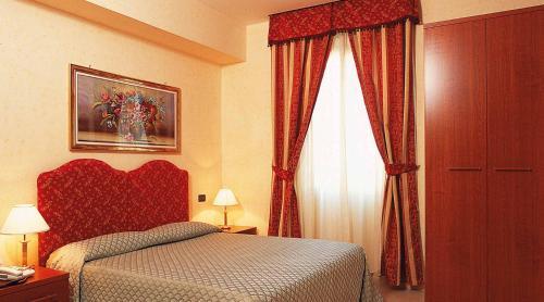 Un ou plusieurs lits dans un hébergement de l'établissement Hotel Stromboli