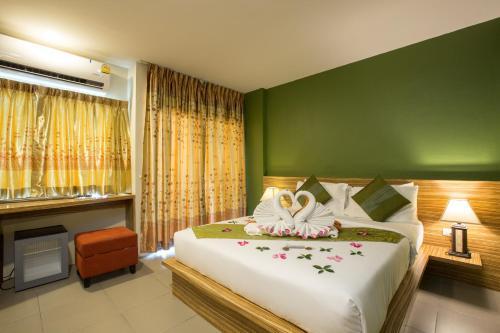 Ein Bett oder Betten in einem Zimmer der Unterkunft Gu Hotel