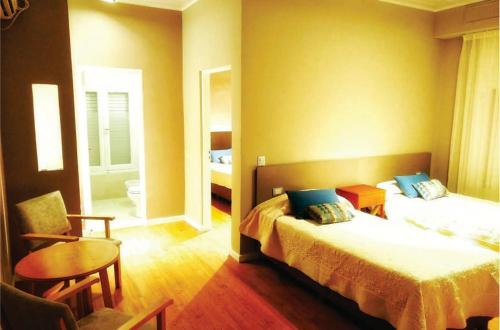 Una cama o camas en una habitación de Grand Hotel Santa Teresita