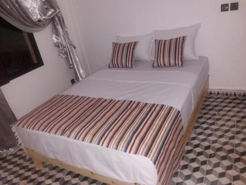 A bed or beds in a room at Atlas Resorts