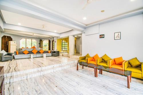 The lobby or reception area at FabEscape Hillscape Villa Khandala