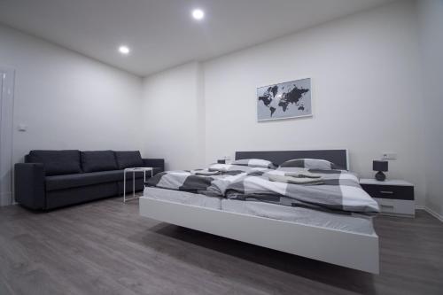 Postel nebo postele na pokoji v ubytování Apartments Susilova