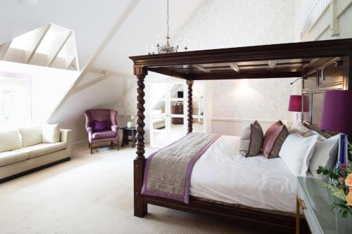 A bed or beds in a room at Pennyhill Park Hotel and Spa