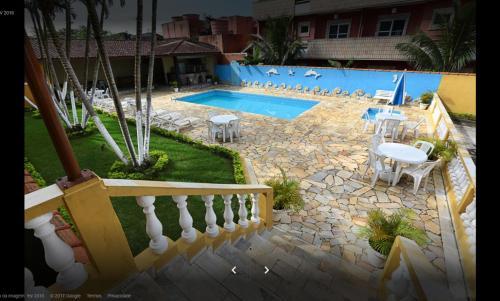 Uma vista da piscina em Hotel Xapuri ou nos arredores