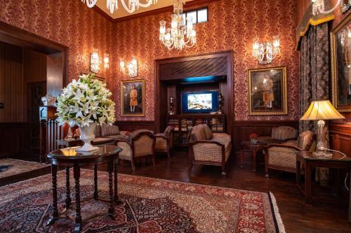 A seating area at The Ajit Bhawan - A Palace Resort