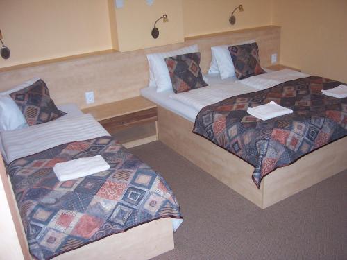 Postel nebo postele na pokoji v ubytování Pension Euro