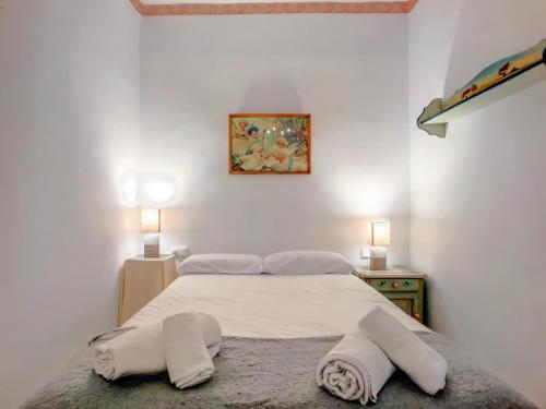 Cama o camas de una habitación en Apartment Bed&BCN Gràcia