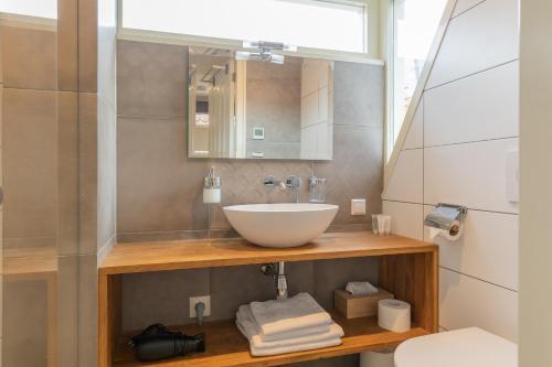 A bathroom at ExLibris Boutique Hotel