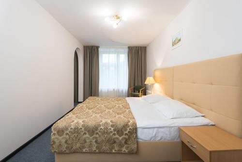 Кровать или кровати в номере Санаторий Буран