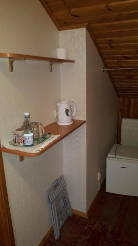 Virtuvė arba virtuvėlė apgyvendinimo įstaigoje Home B&B