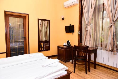 Ένα ή περισσότερα κρεβάτια σε δωμάτιο στο L'Opera House