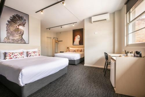A bed or beds in a room at Nightcap at the Charles Hotel