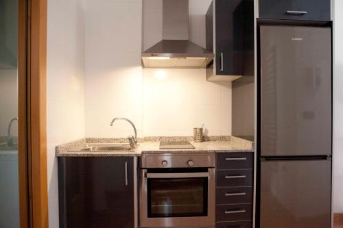 Una cocina o zona de cocina en Happy Apartments Valencia – Lope de Vega