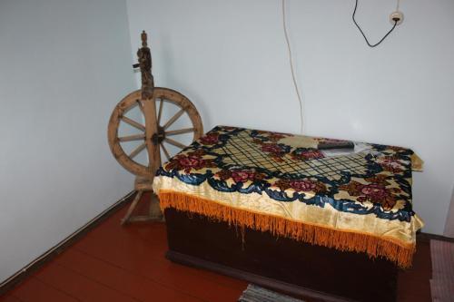 Кровать или кровати в номере Gostinichnyy Kompleks Natasha