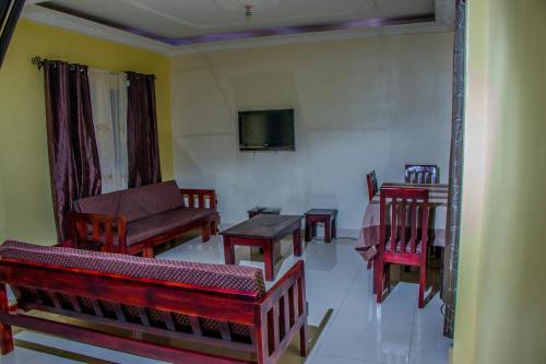 A seating area at Vishi Tower Rest House at Ekoumdoum - Odza