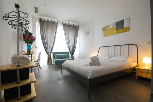 A bed or beds in a room at Quattro Briganti