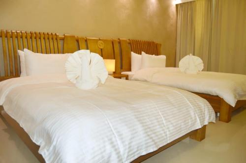 Cama ou camas em um quarto em Yara Suites