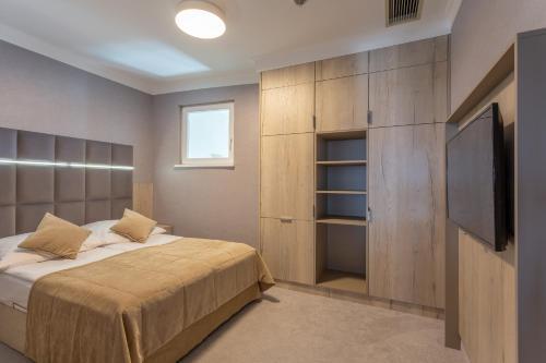 Łóżko lub łóżka w pokoju w obiekcie Hotel Aurora Family & SPA