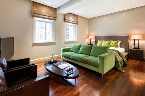 A seating area at Radisson Blu Edwardian Kenilworth Hotel, London