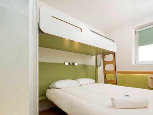 A bunk bed or bunk beds in a room at ibis budget London Hounslow