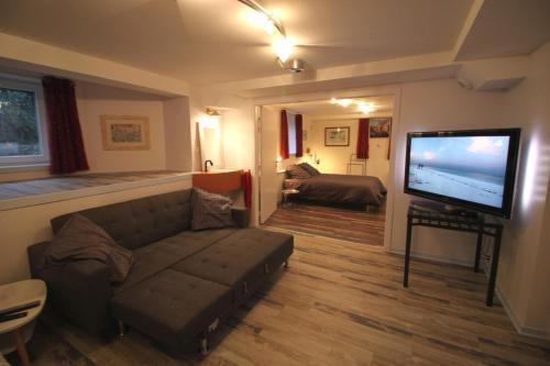 A seating area at Confort et calme à Colmar