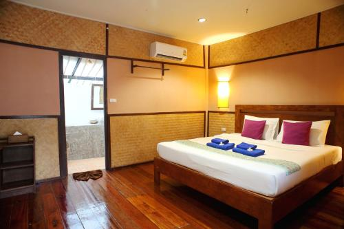 A bed or beds in a room at Mayalay Beach Resort